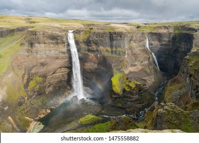 Dramatic overview of Haifoss waterfall, the fourth highest waterfall(122m) of the island, and  colorful canyon situated near the volcano Hekla in southern Iceland.