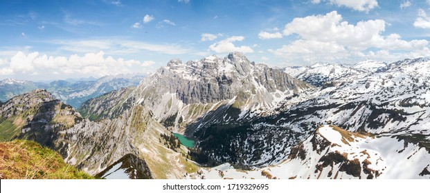 Dramatic panoramic view of snow covered mountains in the swiss alps as seen from the top of Fronalpstock mountain at Canton Glarus in Switzerland