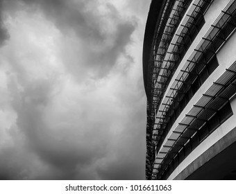 Dramatic perspective architectural black and white. Abstraction of curves metal grill  protection for education building.