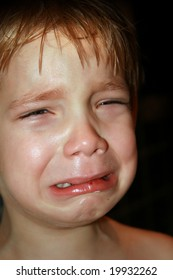 Dramatic photo of a kid crying
