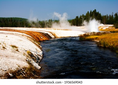 Dramatic pictured jeweled-like colored geysers in Yellowstone National Park, Wyoming that sits atop a volcanic hot spot draw tourists to it yearly.