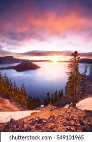 Dramatic pink sunrise at Crater Lake National Park