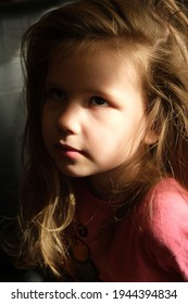 Dramatic portrait of beautiful sad little child girl with shadow on face. lonely in dark. Childhood and problems of parents and children concept. unknown and extraordinary child's soul and inner world