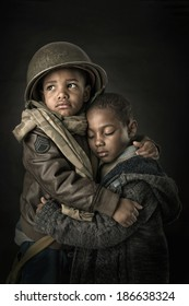 Dramatic portrait of boy soldier protecting his young brother