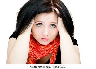 Dramatic portrait of a frightened girl with a very emotional expression isolated on a white background