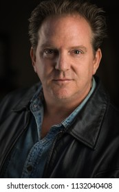 Dramatic Portrait Head Shot of Middle Aged Man