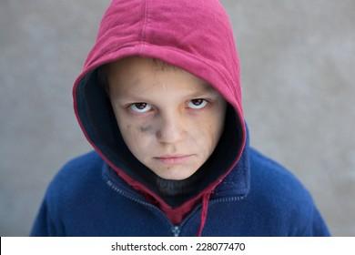 dramatic portrait of a homeless boy
