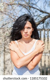 A dramatic portrait of a hot sultry brunette with long black hair without makeup