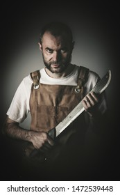 dramatic portrait of a killer holding a machete, concept of danger and image suitable for the horror theme.