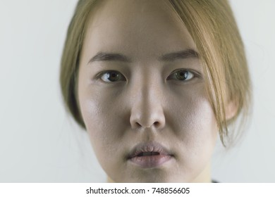 dramatic portrait of mongolian women, looking into the camera. Gray background  - Shutterstock ID 748856605