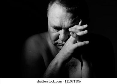 Dramatic portrait of sad senior man