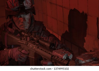 Dramatic portrait of a US military marine. Blood