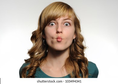 Dramatic Pucker. Teenage girl making a dramatic pucker expression with her face. Note: not isolated.