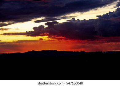 Dramatic red and purple sunset over the mountains