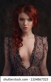 Dramatic retro portrait of a young beautiful dreamy redhead woman. Soft vintage toning