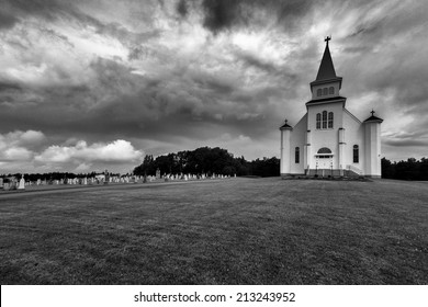 Dramatic and Scary Black and White of Church and Cemetery St Peters Prince Edward Island Canada