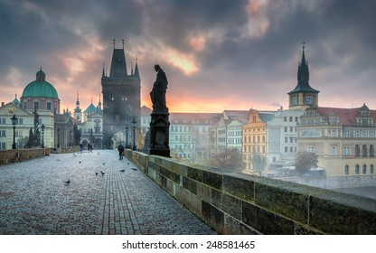 Dramatic scene with cloudy sunrise sky as seen from the Charles bridge in Prague