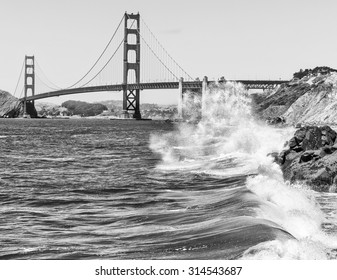 Dramatic scene of pacific waves crashing in front of the Golden Gate Bridge