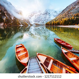 Dramatic scenery of alpine lake Braies (Pragser Wildsee). Location Dolomiti Alps, national park Fanes-Sennes-Braies, Italy, Europe. Scenic image of attractive autumn day. Discover the beauty of earth.