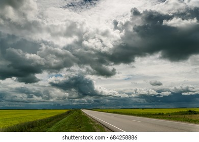 Dramatic scenery. Road in the fields