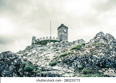 Dramatic and scenic look of the Medieval castle on the rock hill - Folgosinho Castle in Portugal, Europe