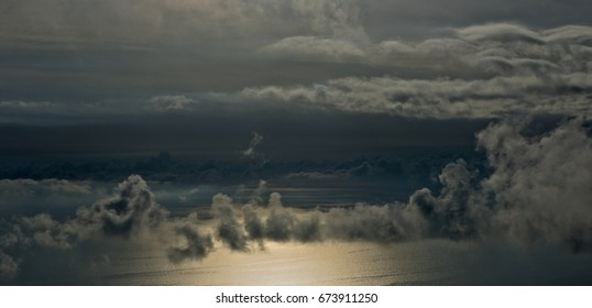 Dramatic sea sunset with low clouds
