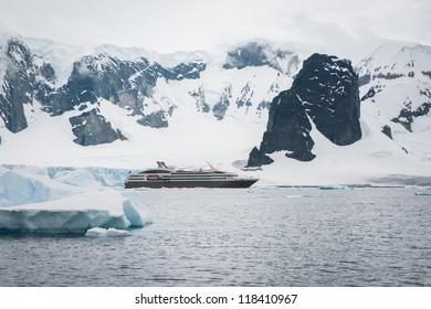 Dramatic seascape in Antarctica, cruise ship in the sea