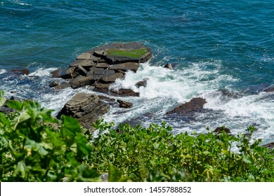 Dramatic Seascape. Crashing waves on the rocks off of Point Fermin in San Pedro, California, USA.