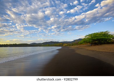 Dramatic skies and flowing water at sunset in Guanacaste