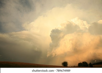 Dramatic sky with big clouds above Pasterka village in Table Mountain in Poland. Stormy weather, natural armagedon.