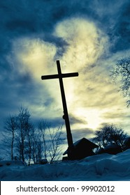 Dramatic sky cloud with deep blue  heart shape shining behind Jesus cross