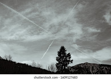 Dramatic Sky with a cross by airplanes