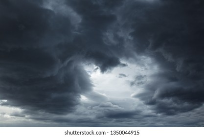 Dramatic sky with dark stormy clouds before thunderstorm natural background