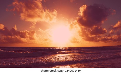 Dramatic sky daybreak over the sea landscape. Exoticism sunset or sunrise - dawn with beautiful sun and clouds on morning beach. Nice ocean background with daybreak over the sea