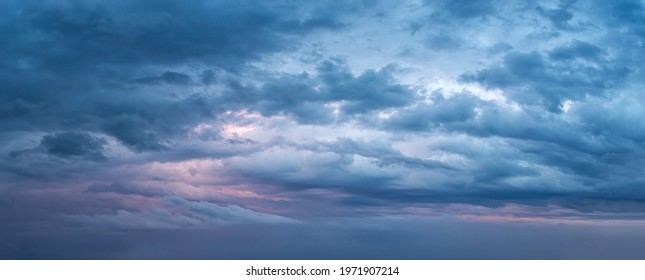 Dramatic sky at evening panoramic shot. Scenic blue gray clouds before the storm. Overcast cloudscape before the rain. Blue hour stormy cloudscape. Dark thunderstorm sky wide image. Sky only. - Shutterstock ID 1971907214