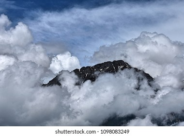 Dramatic sky formation around a mountain peak