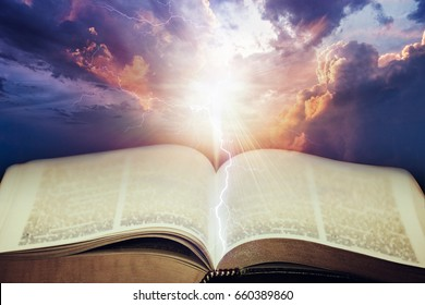 Dramatic sky with open Bible