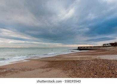 Dramatic sky over the beach and English Channel. Concrete groynes and pebbles are a feature of the beach around Hove and Shoreham.
