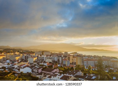 Dramatic sky over city Ponta Delgada, Azores, San Miguel (Sao Miguel) island. Early morning