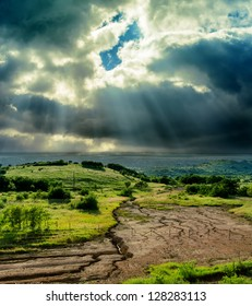 dramatic sky over drought earth