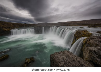 Dramatic sky over Godafoss waterfall in Iceland