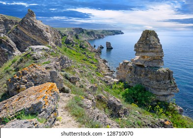 Dramatic sky over mountains, spring grass and blue sea. Spring landscape, Crimea