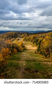 Dramatic sky over the path that leads to the cabin on Mont-Tremblant at Fall. Quebec, Canada