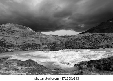 Dramatic sky over waterfalls in Torres del Paine National Oark, Patagonia, Chile