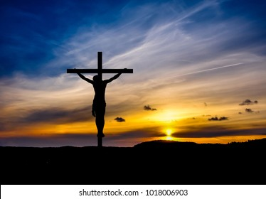 Dramatic sky, silhouette cross