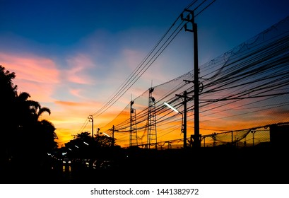 Dramatic sky with silhouette of electricity pole and wire