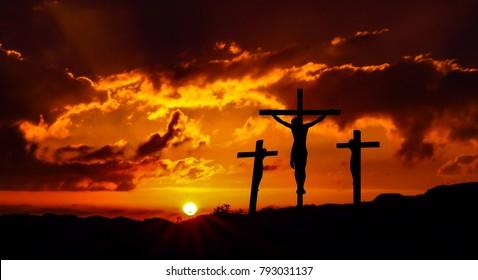 Dramatic sky silhouettes three crosses