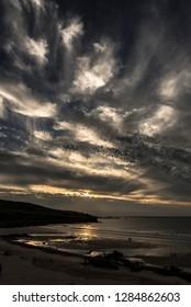Dramatic sky as the sun goes down Porthmeor surf beach Stives Cornwall UK Europe