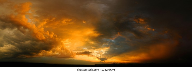 Dramatic sky at sunset with red, yellow and orange colors.