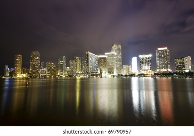 Dramatic skyline of downtown Miami and Biscayne Bay at night time